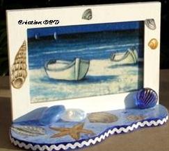 cadre tableau mer bateau coquillages